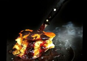 Halloween Spooky soul representing Banana Pancakes with Strawberry Sauce: